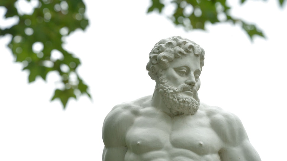 12 June 2020, Saxony, Lützschnena: Hercules stands as a statue in the castle park of Lützschena near Leipzig.