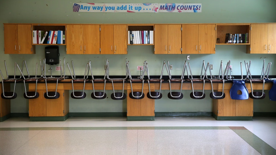 BOSTON - JULY 11: A finished clean room with stacked chairs in the science room at the Mildred Avenue K-8 School building in Boston's Mattapan, which were being cleaned for the reopening of school on July 9, 2020. Many measures are being taken by school systems to keep students safe from the COVID-19 pandemic including placing social distancing markers on the floors, increasing hand sanitizer stations, and increased cleaning. (Photo by David L. Ryan/The Boston Globe via Getty Images)
