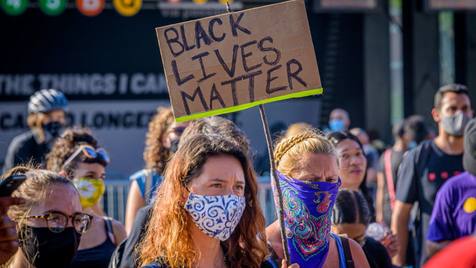 A participant holding a Black Lives Matter sign at the protest.