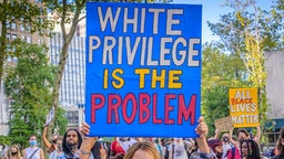 BROOKLYN, NEW YORK, UNITED STATES - 2020/09/05: A participant holding a White Privilege Is The Problem sign at the protest. Brooklynites gathered at Cadman Plaza for a march in the streets of Brooklyn, bringing light to Black Women affected by police violence and to amplify the movement against police brutality and racial injustice. Riders For Black Lives participated by sending bikes to act as a buffer and shield protesters from cars and police. (Photo by Erik McGregor/LightRocket via Getty Images)