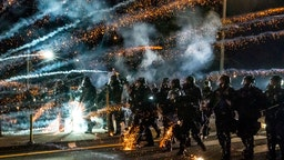 PORTLAND, OREGON - SEPTEMBER 5: Oregon State Troopers and Portland police advance through tear gas and fire works while dispersing a protest against police brutality and racial injustice on September 5, 2020 in Portland, Oregon. Portland has seen nightly protests for the past 100 days following the death of George Floyd in police custody. (Photo by Nathan Howard/Getty Images)