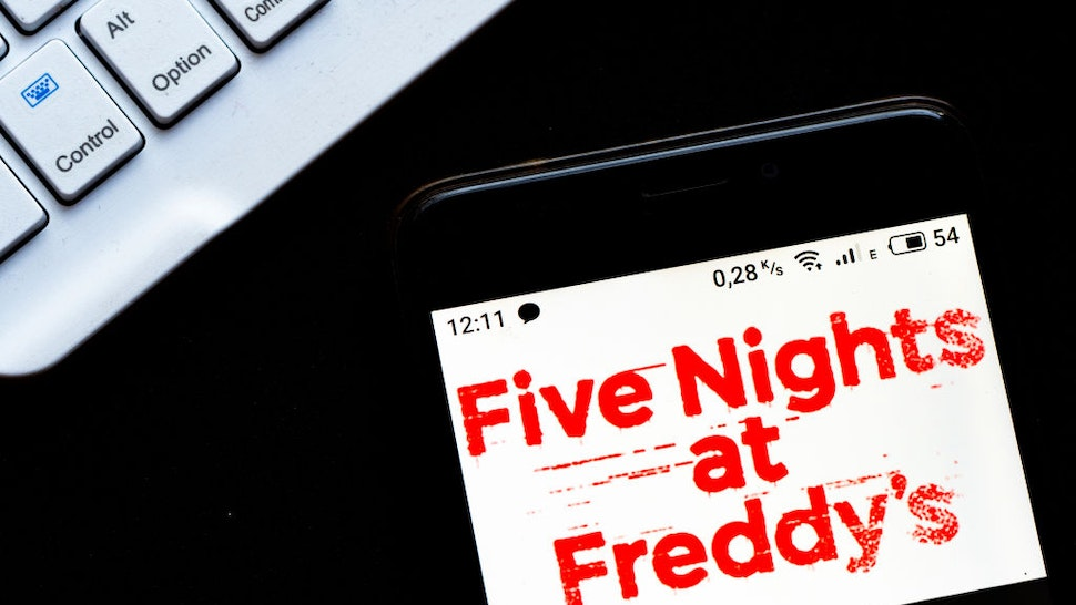 UKRAINE - 2020/10/27: In this photo illustration a Five Nights at Freddy's point-and-click survival horror video game logo seen displayed on a smartphone. (Photo Illustration by Igor Golovniov/SOPA Images/LightRocket via Getty Images)