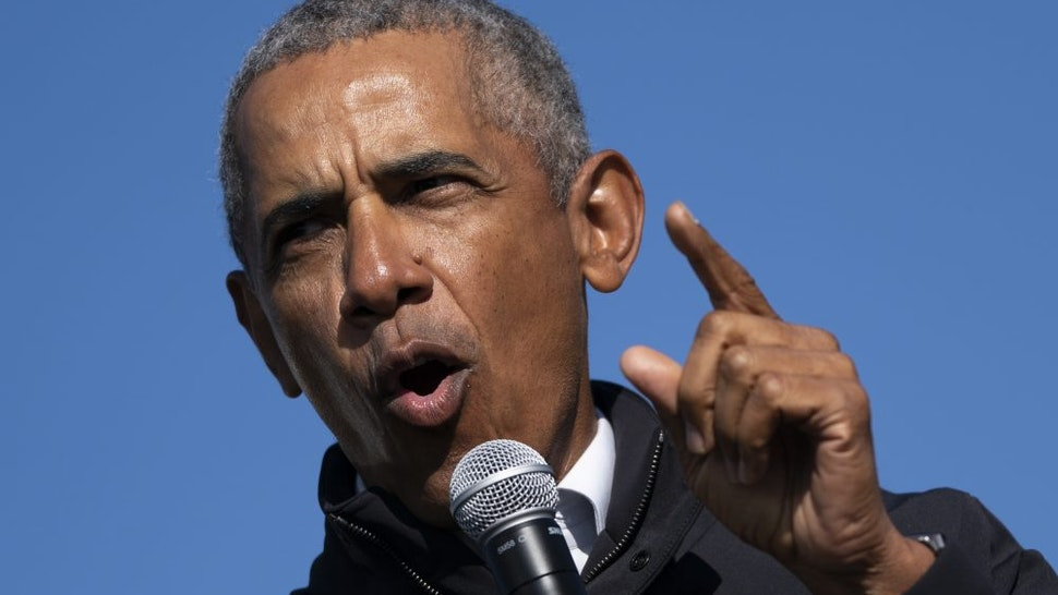 FLINT, MI - OCTOBER 31: Former U.S. President Barack Obama speaks during a drive-in campaign rally for Democratic presidential nominee Joe Biden at Northwestern High School on October 31, 2020 in Flint, Michigan. Biden is campaigning with former President Obama on Saturday in Michigan, a battleground state that President Donald Trump narrowly won in 2016.
