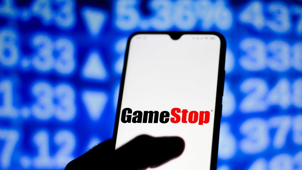 BRAZIL - 2021/02/01: In this photo illustration the GameStop logo seen displayed on a smartphone screen.