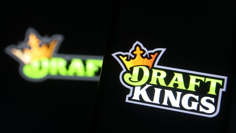 UKRAINE - 2021/02/04: In this photo illustration a DraftKings logo, of the U.S. daily fantasy sports contest and sports betting operator, is seen on a mobile phone screen.