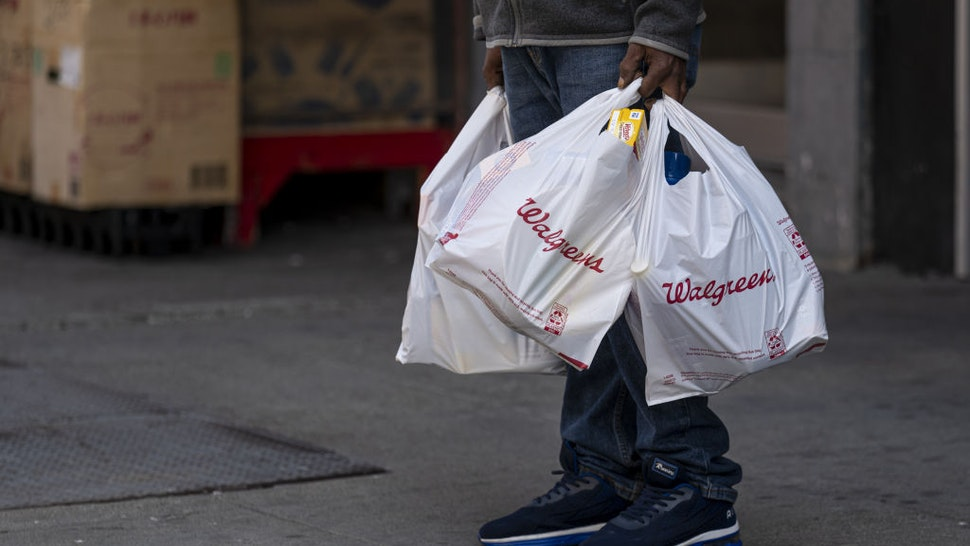 A person holds Walgreens shopping bags in front of a store in San Francisco, California, U.S., on Tuesday, April 13, 2021. Walgreens Boots Alliance Inc. is scheduled to release earnings figures on April 15. Photographer: David Paul Morris/Bloomberg via Getty ImagesA person holds Walgreens shopping bags in front of a store in San Francisco, California, U.S., on Tuesday, April 13, 2021. Walgreens Boots Alliance Inc. is scheduled to release earnings figures on April 15. Photographer: David Paul Morris/Bloomberg via Getty Images