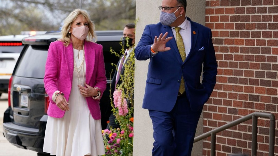 First lady Jill Biden and Education Secretary Miguel Cardona arrive for a visit to the Sauk Valley Community College, in Dixon, Illinois, on April 19, 2021. - Biden and Cardona will be touring the Sauk Valley Community College in Dixon. (Photo by Susan Walsh / POOL / AFP) (Photo by SUSAN WALSH/POOL/AFP via Getty Images)