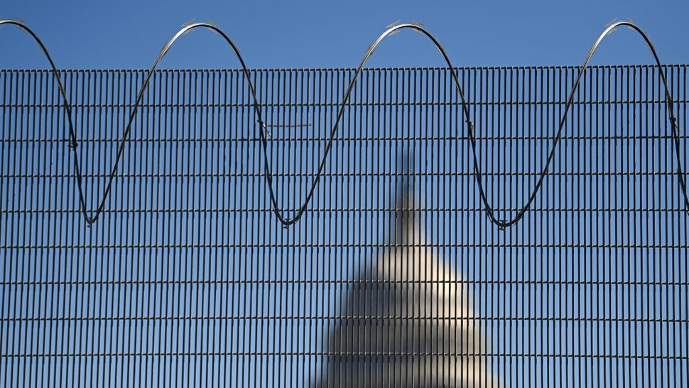 WASHINGTON, DC - FEBRUARY 25: Fencing that surrounds the United States Capitol is seen on Thursday February 25, 2021 in Washington, DC. The fencing went up following the riot at the Capitol on January 6th by a pro-Trump mob. (Photo by Matt McClain/The Washington Post via Getty Images)