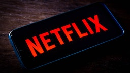 In this photo illustration the Netflix logo seen displayed on a smartphone screen.