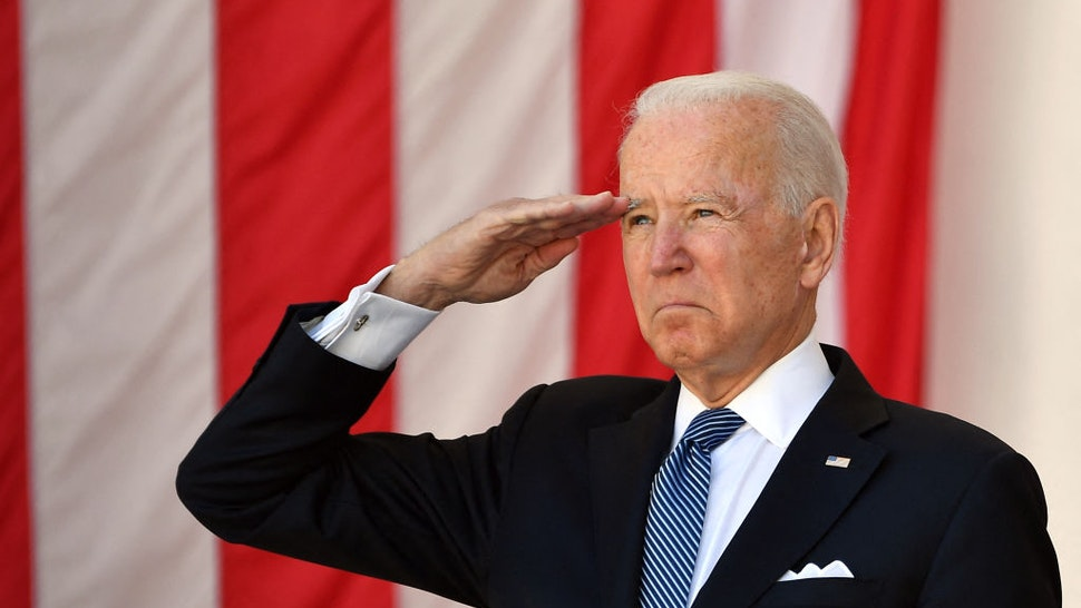 US President Joe Biden salutes before delivering an address at the 153rd National Memorial Day Observance at Arlington National Cemetery on Memorial Day in Arlington, Virginia on May 31, 2021.