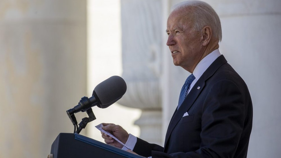 U.S. President Joe Biden speaks during a Memorial Day ceremony at Arlington National Cemetery in Arlington, Virginia, U.S., on Monday, May 31, 2021. Biden's $6 trillion budget request proposes record spending to reduce historical disparities in underserved communities, following his campaign pledge to promote racial equity as an inseparable part of rebuilding the economy.