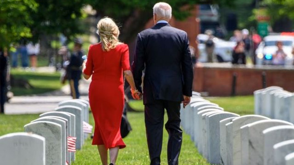 US President Joe Biden and First Lady Jill Biden walk through Section 12 of Arlington National Cemetery, after the 153rd National Memorial Day Observance on Memorial Day in Arlington, Virginia on May 31, 2021. (Photo by MANDEL NGAN / AFP) (Photo by MANDEL NGAN/AFP via Getty Images)