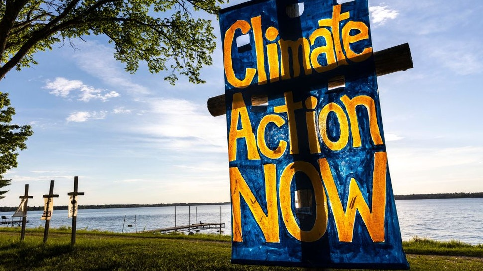 Call for climate action and Line 3 pipeline protest signs are seens during the Treaty People Gathering where Faith Leaders Welcome Talk and Sunset Prayer Circle will take place at Northern Pines Camp in Park Rapids, Minnesota on June 5, 2021. - Line 3 is an oil sands pipeline which runs from Hardisty, Alberta, Canada to Superior, Wisconsin in the United States. In 2014, a new route for the Line 3 pipeline was proposed to allow an increased volume of oil to be transported daily. While that project has been approved in Canada, Wisconsin, and North Dakota, it has sparked continued resistance from climate justice groups and Native American communities in Minnesota. While many people are concerned about potential oil spills along Line 3, some Native American communities in Minnesota have opposed the project on the basis of treaty rights and calling President Biden to revoke the permits and halt construction. (Photo by Kerem Yucel / AFP) (Photo by KEREM YUCEL/AFP via Getty Images)
