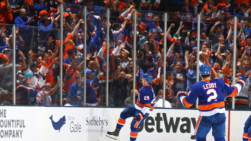 UNIONDALE, NEW YORK - JUNE 09: Brock Nelson #29 of the New York Islanders celebrates after scoring a goal against the Boston Bruins as fans cheer during the second period in Game Six of the Second Round of the 2021 Stanley Cup Playoffs at Nassau Coliseum on June 09, 2021 in Uniondale, New York. (Photo by Mike Stobe/NHLI via Getty Images)