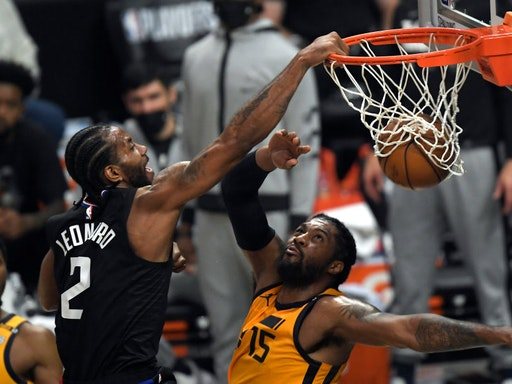 LOS ANGELES, CA - JUNE 14: (EDITOR'S NOTE: Alternate crop) Kawhi Leonard #2 of the Los Angeles Clippers slam dunks against Derrick Favors #15 of the Utah Jazz during the first half in Game Four of the Western Conference second-round playoff series at Staples Center on June 14, 2021 in Los Angeles, California. NOTE TO USER: User expressly acknowledges and agrees that, by downloading and or using this photograph, User is consenting to the terms and conditions of the Getty Images License Agreement. (Photo by Kevork Djansezian/Getty Images)