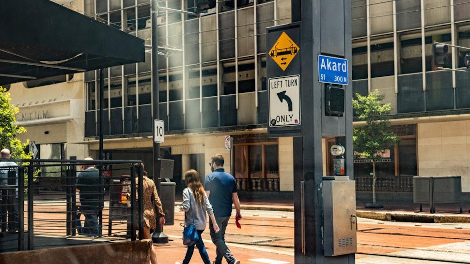 Pedestrians walk down a street during a heatwave in Dallas, Texas, U.S., on Thursday, June 17, 2021.