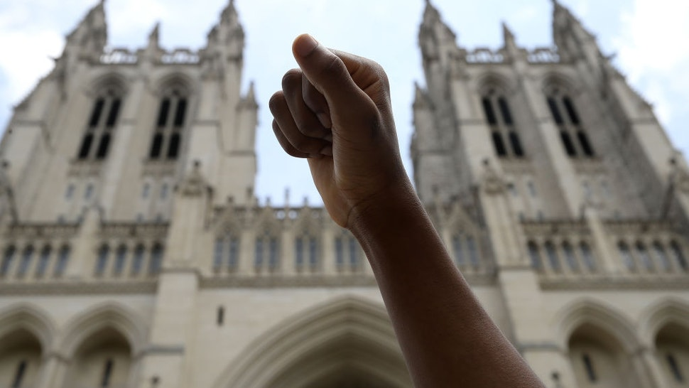 WASHINGTON, DC - JUNE 05: A student holds up a fist during a Black Lives Matter sit-in at the National Cathedral during a peaceful protest against police brutality and the death of George Floyd, on June 5, 2020 in Washington, DC. Protests in cities throughout the country are largely peaceful in the wake of the death of George Floyd, a black man who was killed in police custody in Minneapolis on May 25. (Photo by Win McNamee/Getty Images)