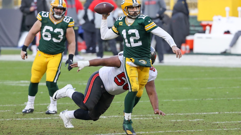 GREEN BAY, WISCONSIN - JANUARY 24: Aaron Rodgers #12 of the Green Bay Packers throws a pass in the third quarter against the Tampa Bay Buccaneers during the NFC Championship game at Lambeau Field on January 24, 2021 in Green Bay, Wisconsin. (Photo by Dylan Buell/Getty Images)