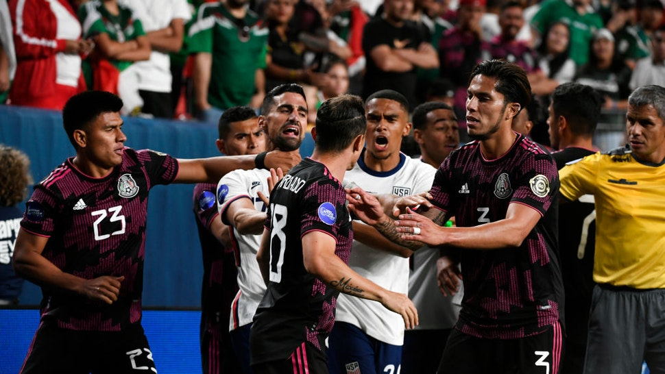 """DENVER, COLORADO - MAY 6: Mexico""""u2019s #23 Jesus Gallardo, left, puts his hand on the throat of United States""""u2019 Midfielder Sebastian Lletget, #17 as Midfielder Andres Guardado, #18, center, gets in a shouting match with United States""""u2019 Defender Reggie Cannon, #20 and Mexico""""u2019s Carlos Salcedo, #3, tries to keep the peace during the championship game at the Concacaf Nations League Finals at Empower Field at Mile High on June 6, 2021 in Denver, Colorado. The United States beat Mexico 3 to 2 in a heated game that lasted over two hours. (Photo by Helen H. Richardson/MediaNews Group/The Denver Post via Getty Images)"""