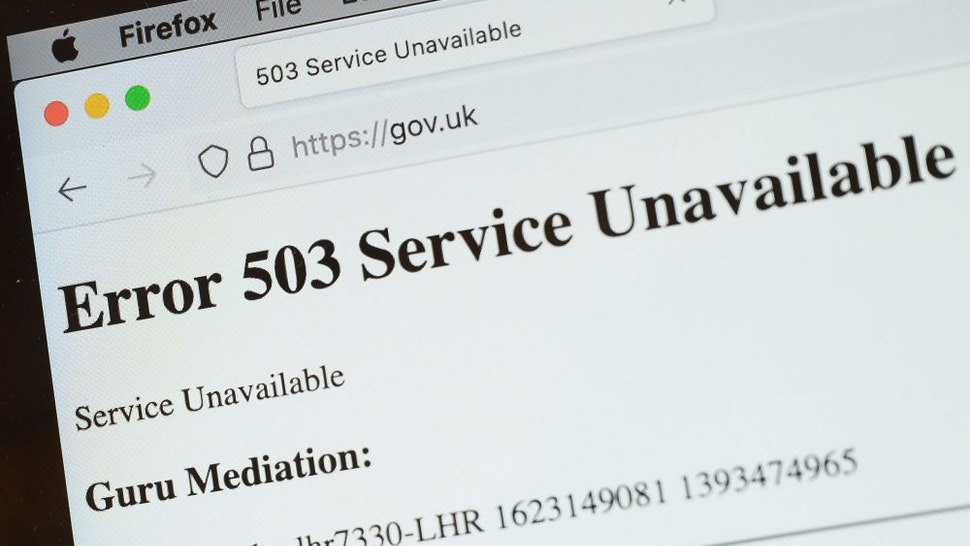 """LONDON, ENGLAND - JUNE 08: In this Photo illustration, a screen displays a holding page of the Gov.UK Government website portal on June 08, 2021 in London, England. A wide range of major websites including eBay, Paypal, The Financial Times, Reddit, Twitch and The Guardian were taken offline due to what is believed to be an issue with the Fastly cloud hosting service. Some of the affected websites displayed the message """"Error 503 Service Unavailable."""""""