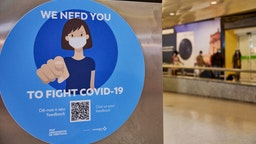 LISBON, PORTUGAL - JUNE 17: Mask-clad arriving travelers walk with their luggage behind a COVID-19 related advertising at the arrivals hall of Terminal 1 in Humberto Delgado International Airport a day after the country started issuing the first Immune certificates, as part of the European Union's COVID-19 Digital Certificate, during COVID-19 Coronavirus pandemic on June 17, 2021 in Lisbon, Portugal. Traveling becomes safer and easier for Portuguese residents as the vaccination certificates will be made available for all users of the country's National Health Service, and the DGS indicated that it will issue three different certificates, namely, the vaccination certificate, the test certificate, and the recovery certificate. (Photo by Horacio Villalobos#Corbis/Corbis via Getty Images)