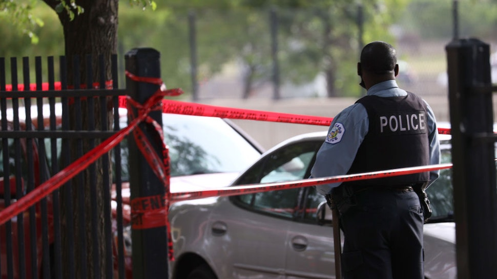 CHICAGO, ILLINOIS - JUNE 23: Police investigate a crime scene where three people were shot at the Wentworth Gardens housing complex in the Bridgeport neighborhood on June 23, 2021 in Chicago, Illinois. A 24-year-old man died from injuries he suffered in the shooting and two others, a 22-year-old male and a 25-year-old male, were seriously wounded. (Photo by Scott Olson/Getty Images)