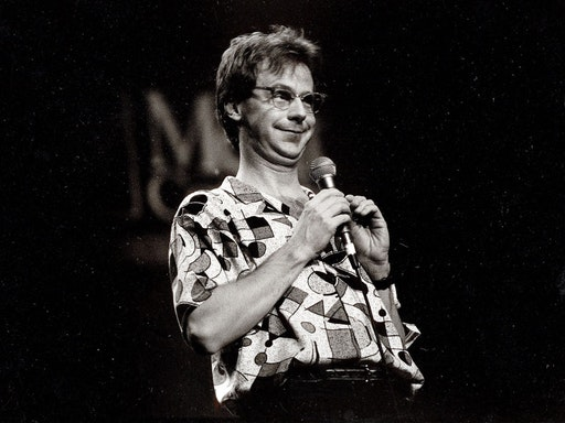 View of comedian Dana Carvey performing onstage, Chicago, Illinois, November 4, 1990. (Photo by Paul Natkin/Getty Images)
