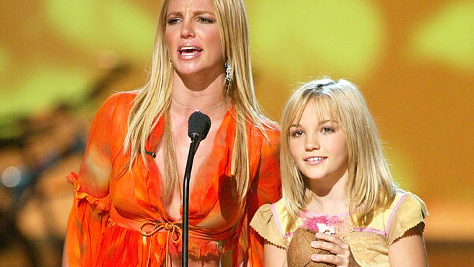 """Britney Spears and her sister Jamie Lynn Spears at """"The Teen Choice Awards 2002"""" at the Universal Amphitheatre in Los Angeles, Ca. Sunday, August 4, 2002."""