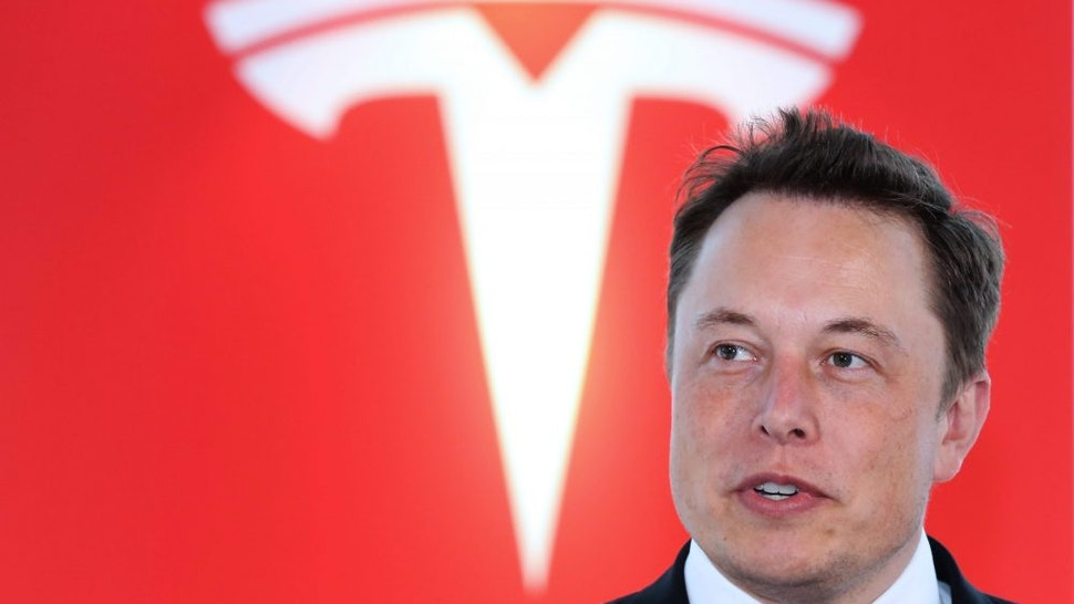 Elon Musk, co-founder and chief executive officer of Tesla Motors Inc., attends a key delivery ceremony of the company's premium electric sedan Model S vehicles to customers in Tokyo, Japan, on Monday, Sept. 8, 2014. Tesla may partner with Toyota Motor Corp. again in the future, Musk said.