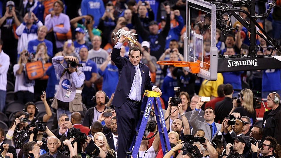 INDIANAPOLIS, IN - APRIL 06: Head coach Mike Krzyzewski of the Duke Blue Devils cuts down the net after defeating the Wisconsin Badgers during the NCAA Men's Final Four National Championship at Lucas Oil Stadium on April 6, 2015 in Indianapolis, Indiana. Duke defeated Wisconsin 68-63. (Photo by Joe Robbins/Getty Images)