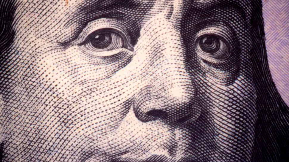 A close up photo of Benjamin Franklin, one of the founding fathers of the United States, as seen on a US $100 Federal Reserve Note November 17, 2015 at the Department of the Treasury, Bureau of Engraving and Printing in Washington, DC. AFP PHOTO/PAUL J. RICHARDS (Photo by Paul J. RICHARDS / AFP) (Photo by PAUL J. RICHARDS/AFP via Getty Images)