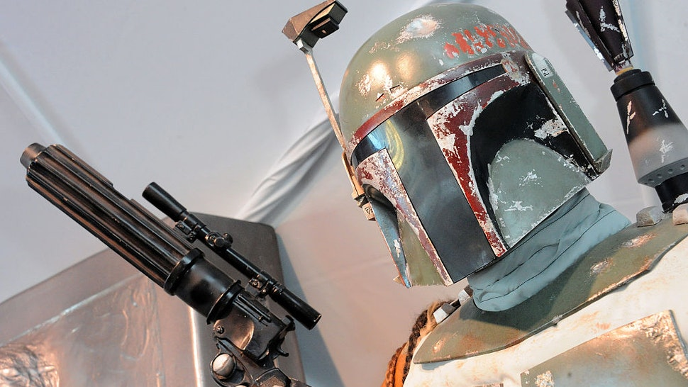 """LOS ANGELES, CA - DECEMBER 13: Hollywood Prepares For The Premiere Of Walt Disney Pictures And Lucasfilm's """"Star Wars: The Force Awakens"""" : Boba Fett on display on the 2nd Day of Target's Share The Force held at LA Live on December 13, 2015 in Los Angeles, California. (Photo by Albert L. Ortega/Getty Images)"""
