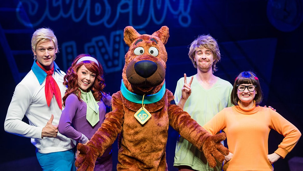 LONDON, ENGLAND - AUGUST 17: (L-R) Chris Warner Drake as Fred, Charlie Bull as Daphne, Joe Goldie as Scooby-Doo, Charlie Haskins as Shaggy and Rebecca Withers as Velma appear on stage in Scooby-Doo Live! at London Palladium on August 17, 2016 in London, England.