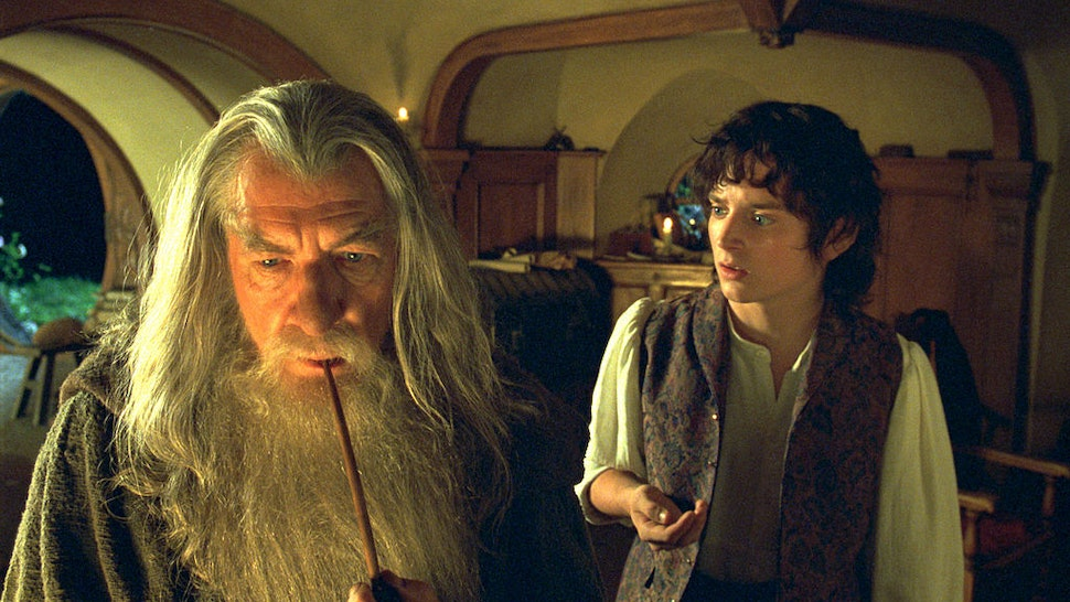 """Academy Award? nominee Fran Walsh & Philippa Boyens & Peter Jackson for Best Adapted Screenplay in New Line Cinema's epic adventure, """"The Lord of the Rings: The Fellowship of the Ring."""" Pictured is Best Supporting Actor nominee Ian McKellen (L) as Gandalf with Elijah Wood as Frodo. (Photo by New Line/WireImage)"""