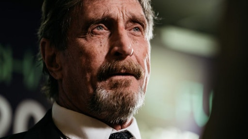 John McAfee, founder of McAfee Associates Inc. and chief cybersecurity visionary at MGTCapital Investments Inc., speaks during a Bloomberg Television interview on the sidelines of the Shape the Future: Blockchain Global Summit in Hong Kong, China, on Wednesday, Sept. 20, 2017. McAfee, who now runs a bitcoin mining company, says China's banning of initial coin offerings won't halt the momentum of cryptocurrencies globally.
