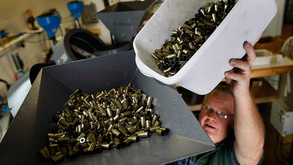 MIAMI - APRIL 09: Adolfo Vivas pours bullet casing into an ammuntion loader as they manufacture 45 caliber cartridges at Stone Hart manufacturing, Co. April 9, 2009 in Miami, Florida. Ammunition suppliers nationwide are reporting a shortage due in part to a sharp rise in gun sales after the election of President Obama that are said to be fueled by fears his administration will usher in more restrictive gun laws. Other factors for the shortage are reported to be the wars in Iraq and Afghanistan and fear of social upheaval due to the worsening economy. (Photo by Joe Raedle/Getty Images)