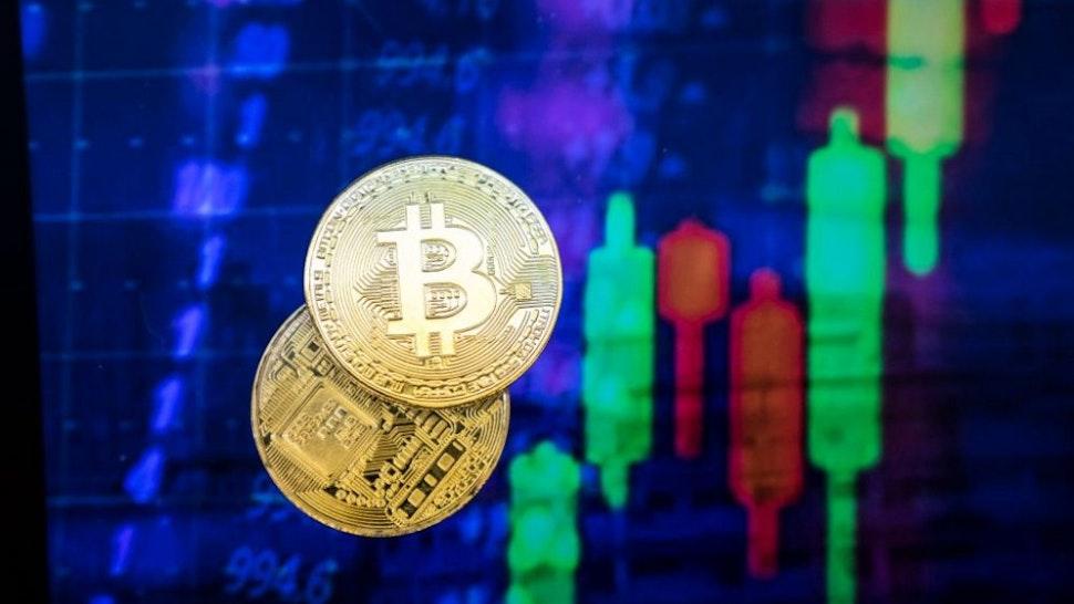 HONG KONG, HONG KONG - NOVEMBER 30: A visual representation of the digital Cryptocurrency, Bitcoin experienced price falls $1,000 in Minutes to drop below $10k on November 30, 2017 in Hong Kong, Hong Kong.