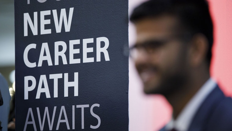 """A sign reading """"New Career Paths"""" is displayed during the TechFair LA career fair in Los Angeles, California, U.S., on Thursday, March 8, 2018. The U.S. Department of Labor is scheduled to release initial jobless claims on March 15. Photographer: Patrick T. Fallon/Bloomberg via Getty Images"""