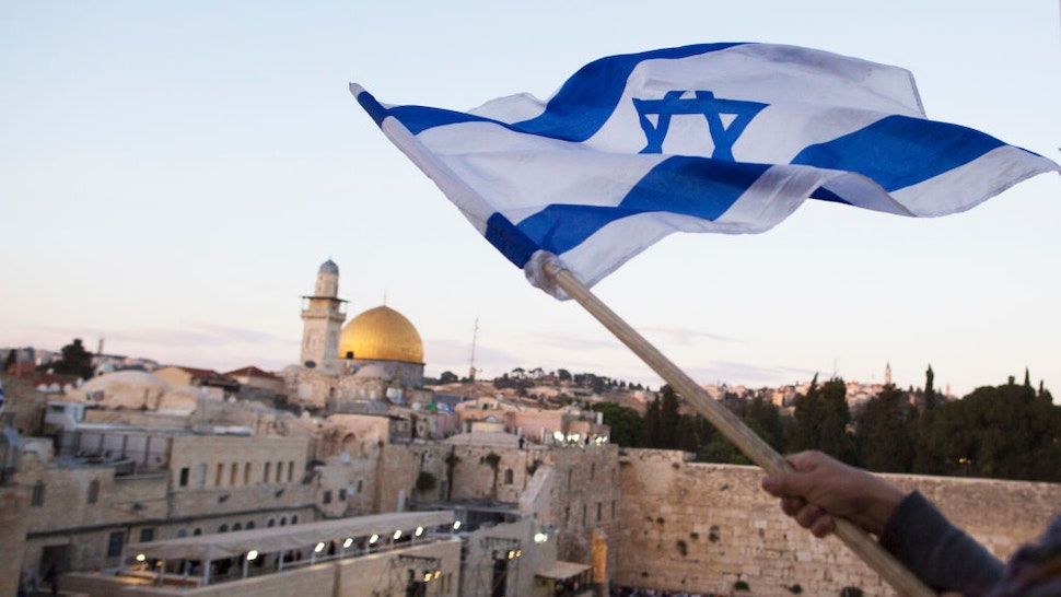 JERUSALEM, ISRAEL - MAY 13: (ISRAEL OUT) Israelis wave their national flags during a march next to the Western Wall on May 13, 2018 in Jerusalem, Israel. Israel mark Jerusalem Day celebrations the 51th anniversary of its capture of Arab east Jerusalem in the Six Day War of 1967. One day before US will move the Embassy to Jerusalem.