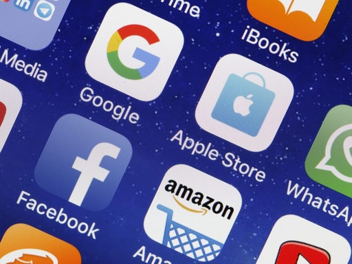 PARIS, FRANCE - MAY 31: In this photo illustration, logos of the Google, Apple, Facebook, and Amazon applications (GAFA) are displayed on the screen of an Apple iPhone on May 31, 2018 in Paris, France. The acronym GAFA refers to the four most powerful companies in the world of the internet: Google, Apple, Facebook and Amazon. The European Union has decided to better tax the giants of the internet with Brussels proposing to tax 3% of income generated by the data of users of Internet companies. This new tax would bring in 5 billion euros a year in the European Union.