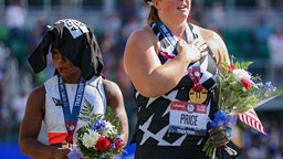 Gwendolyn Berry (L), third place, turns away from U.S. flag during the U.S. National Anthem as DeAnna Price (C), first place, also stands on the podium after the Women's Hammer Throw final on day nine of the 2020 U.S. Olympic Track & Field Team Trials at Hayward Field on June 26, 2021 in Eugene, Oregon. In 2019, the USOPC reprimanded Berry after her demonstration on the podium at the Lima Pan-American Games. (Photo by Patrick Smith/Getty Images)