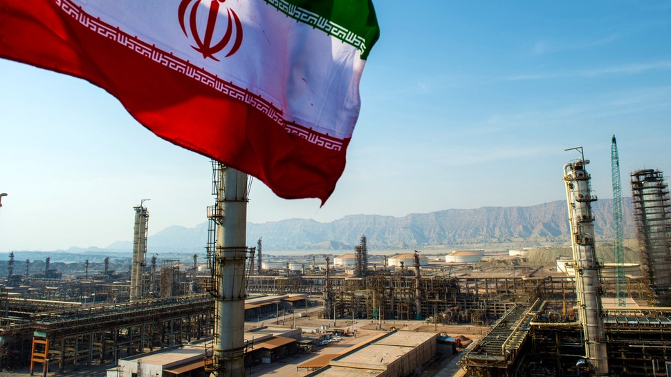 An Iranian national flag flies above the new Phase 3 facility at the Persian Gulf Star Co. (PGSPC) gas condensate refinery in Bandar Abbas, Iran, on Wednesday, Jan. 9. 2019. The third phase of the refinery begins operations next week and will add 12-15 million liters a day of gasoline output capacity to the plant, Deputy Oil Minister Alireza Sadeghabadi told reporters.