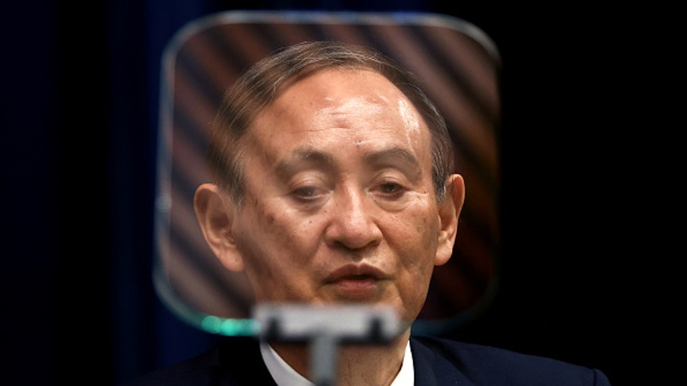 Japan's Prime Minister Yoshihide Suga speaks during a press conference at the prime minister's official residence in Tokyo on May 28, 2021, as the government expanded a coronavirus state of emergency.