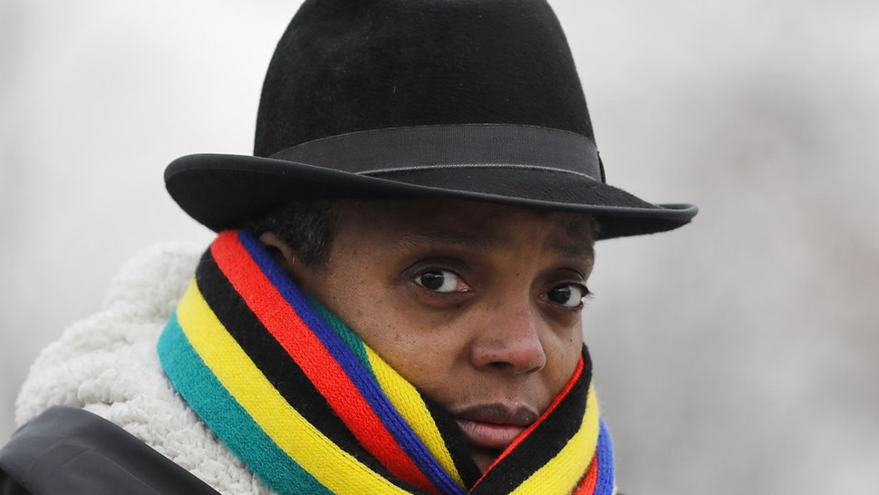 Mayoral candidate Lori Lightfoot campaigns and talks to voters outside of polling station at Tuley Park Cultural Center in Chicago on Election Day, Tuesday, Feb. 26, 2019.