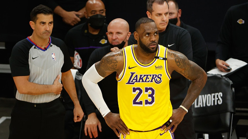 PHOENIX, ARIZONA - MAY 25: LeBron James #23 of the Los Angeles Lakers watches from the bench during the second half of Game Two of the Western Conference first-round playoff series at Phoenix Suns Arena on May 25, 2021 in Phoenix, Arizona. NOTE TO USER: User expressly acknowledges and agrees that, by downloading and or using this photograph, User is consenting to the terms and conditions of the Getty Images License Agreement.