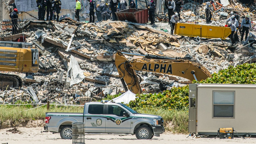 """Search and Rescue teams look for possible survivors in the partially collapsed 12-story Champlain Towers South condo building on June 27, 2021 in Surfside, Florida. - The death toll after the collapse of a Florida apartment tower has risen to nine, the local mayor said on June 27, 2021, more than three days after the building pancaked as residents slept. """"We were able to recover four additional bodies in the rubble... So I am confirming today that the death toll is at nine,"""" Miami-Dade County mayor Daniella Levine Cava told reporters in Surfside, near Miami Beach, adding that one victim had died in hospital. """"We've identified four of the victims and notified next of kin."""""""