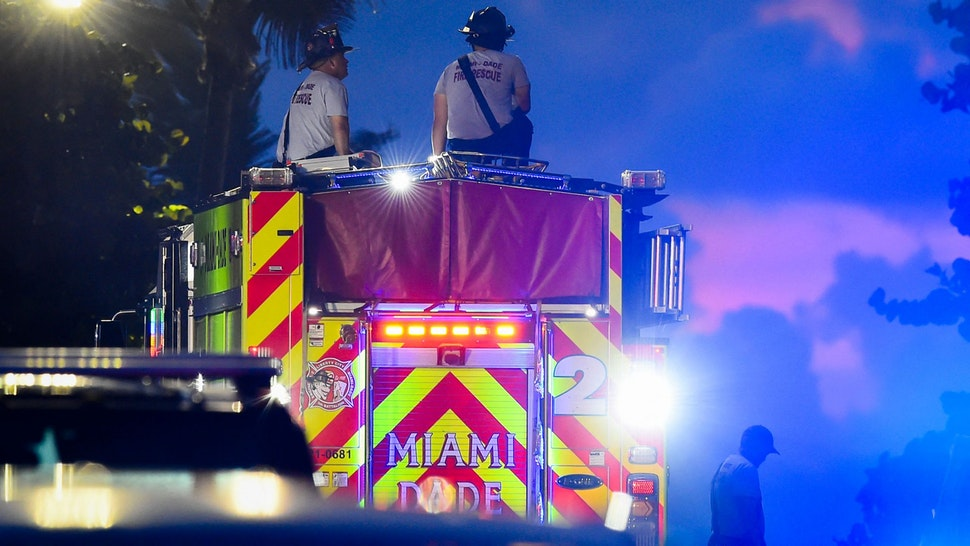 A Miami-Dade firefighter works during a rescue operation of a partially collapsed building in Surfside north of Miami Beach, Florida on June 25, 2021. - Four people are now known to have died in the collapse of an oceanfront apartment building near Miami Beach, officials said Friday, while the number of unaccounted for has risen to 159 -- fueling fears of a much higher death toll.