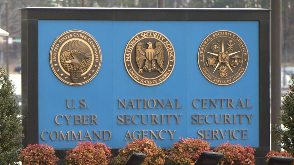 A sign for the National Security Agency (NSA), US Cyber Command and Central Security Service, is seen near the visitor's entrance to the headquarters of the National Security Agency (NSA) after a shooting incident at the entrance in Fort Meade, Maryland, February 14, 2018. - Shots were fired early Wednesday at the ultra-secret National Security Agency, the US electronic spying agency outside Washington, leaving one person injured, officials said. Aerial footage of the scene from NBC News showed a black SUV with numerous bullet holes in its windshield crashed into concrete barriers at the main entrance to the NSA's headquarters in Fort Meade, Maryland.