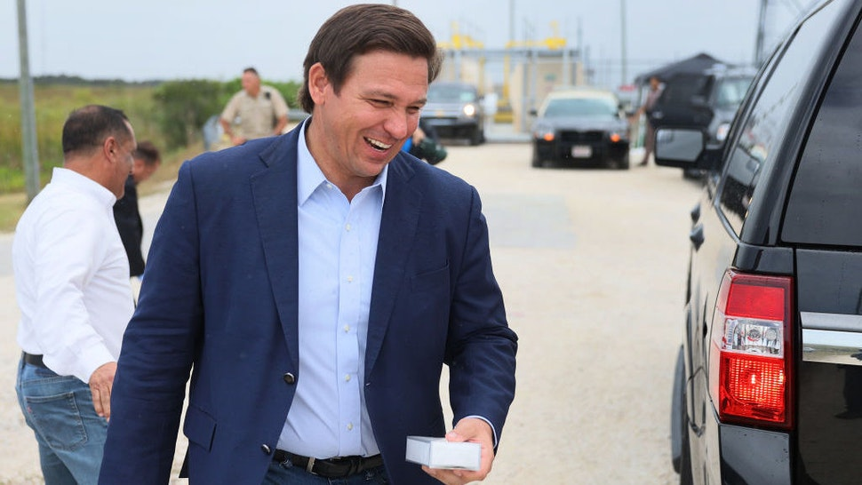 MIAMI, FLORIDA - JUNE 03: Florida Gov. Ron DeSantis leaves after holding a press conference to kickoff the 2021 Python Challenge in the Everglades on June 03, 2021 in Miami, Florida. The 10-day event will run from July 9 to 18, with prizes going to participants who catch the most and the biggest pythons. The event began as a way for hunters to help control the population of the invasive Burmese python in the Florida Everglades. (Photo by Joe Raedle/Getty Images)