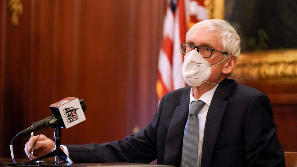 Wisconsin Gov. Tony Evers, a member of Wisconsin's Electoral College, cast his vote at the state Capitol in Madison, Wis., Monday, Dec. 14, 2020. (AP Photo/Morry Gash, Pool)